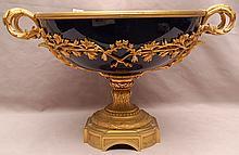 Centerpiece, cobalt blue porcelain with gilded mounts, scrolling handles on bronze pedestal base, 9 3/4'h x 17