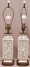 Pair of white oriental reticulated porcelain lamps on brass bases, 23 1/2