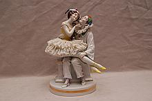 German porcelain jester with seated dancer, 9