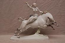 Herend semi-nude on charging steer, 16 1/2