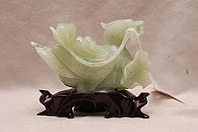 Mythological jade bird with flower in mouth,