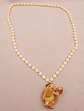 Ladies ivory beaded necklace with ivory netsuke