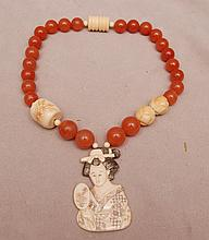 Hard stone bead necklace with ivory pendant
