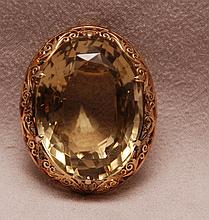 14kt gold frame pin with topaz