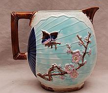 Majolica pitcher, bird in flight