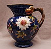 Majolica pitcher, Stoke on Trent, floral with dragon head handle, 9