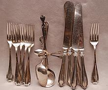 6 sterling forks, 6 sterling spoons and 5 sterling handled knives,