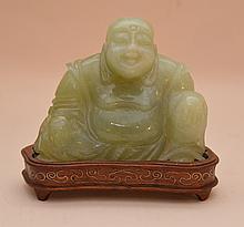 Carved jade buddha on custom wood base, 3 1/2