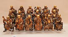 Set of 18 carved wood buddhas, each approx.  4 3/4