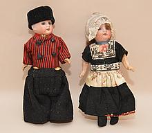 Pair of German girl and boy dolls with bisque heads, 8 1/2