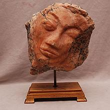 Carved pink granite face, 11