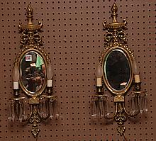 Pair of brass oval sconces, 23