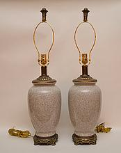 Pair of porcelain lamps on decorated footed attached brass supports, 30
