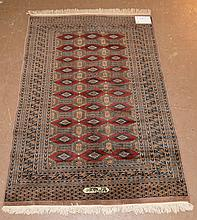 Carpet, 7 row border with center red and navy, tan with cotton fringe, signed, 4' x 6'1