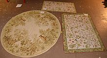 3 needlepoint carpets, (1) round with tigers and (2) small florals