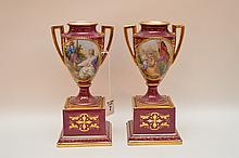 Pair Vienna Porcelain Vases each with romantic scene.  Ht. 8 1/2