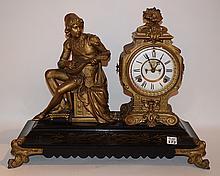 Gilt Metal & Ebonized Clock.  Ht. 16 1/2