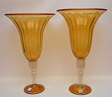 Pair of amber glass urns, 23