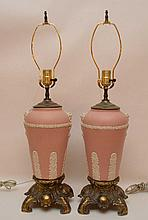 Pair of pink jasperware lamps attached to fancy footed brass supports, 25
