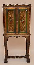 Painted green/red carved court cupboard on trestle base, 60 1/2