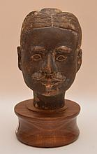 Chinese Terra Cotta Bust mounted on a wood stand.  Ht. 8 1/2
