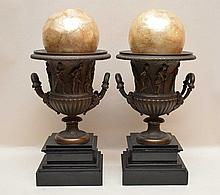 Pair Bronze Urns On Marble Bases.  One Urn has a crack to the interior shoulder.  Ht. 11 1/4