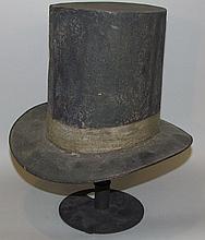Tin top hat trade sign