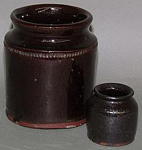 2 PA lead glazed redware jars