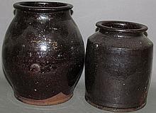 2 manganese glazed redware jars