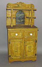 Yellow painted child's cupboard
