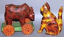 2 folk art carvings