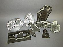 9 assorted tin cookie cutters