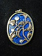 A yellow metal mounted lapis lazuli oval pendant,