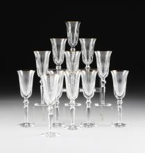 A SET OF TWELVE WATERFORD CUT CRYSTAL AND GOLD RIM FLUTED CHAMPAGNE FLUTES,