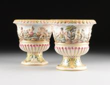 A PAIR OF CAPODIMONTE STYLE POLYCHROME PAINTED AND MOLDED PORCELAIN VASES, PROBABLY DRESDEN, UNDERGLAZE BLUE CROWNED