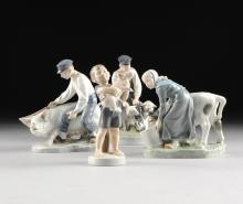 A COLLECTION OF FOUR ROYAL COPENHAGEN POLYCHROME PAINTED PORCELAIN FIGURES OF DUTCH FARMERS WITH LIVESTOCK, GREEN AND BLUE MAKER'S MARKS, 20TH CENTURY,