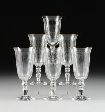 A SET OF SIX WATERFORD CUT CRYSTAL AND GOLD RIM WATER GOBLETS,