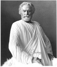 AN AUTOGRAPHED BLACK AND WHITE PHOTOGRAPH OF SIR LAURENCE OLIVIER AS ZEUS IN UNITED ARTISTS 1981 FILM CLASH OF THE TITANS AND TWO PUBLICITY IMAGES,