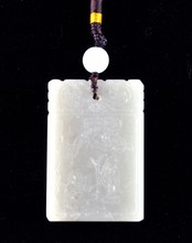 A CHINESE CARVED CELADON JADE PENDANT,