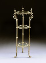 A THREE TIERED BRASS STAND WITH BEVELED GLASS SHELVES, 19TH CENTURY,