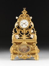 AN UNUSUAL NAPOLEON III FLORAL ENCRUSTED GILT PRESSED METAL MANTLE CLOCK, FOR THE TURKISH MARKET, MECHANISM BY VINCENTI ET CIE, CIRCA 1855,