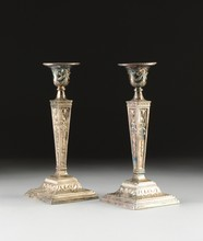 A PAIR OF NEOCLASSICAL STYLE SILVER PLATED REPOUSSÉ CANDLESTICKS,