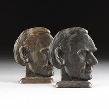 A PAIR OF VINTAGE AMERICAN PATINATED BRONZE LINCOLN BOOKENDS, SIGNED C.I. BECK, 20TH CENTURY,