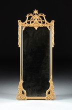 A NEOCLASSICAL STYLE CARVED GILTWOOD MIRROR, FIRST HALF 20TH CENTURY,