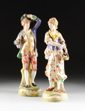 A PAIR OF CONTINENTAL DERBY STYLE POLYCHROME ENAMEL AND GILT DECORATED PORCELAIN FIGURES, POSSIBLY FRANCE, CIRCA 1920,