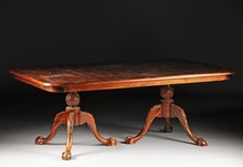A CHIPPENDALE STYLE MAHOGANY DINING TABLE, 20TH CENTURY,