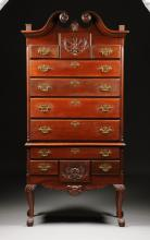 AN AMERICAN CHIPPENDALE STYLE CARVED MAHOGANY HIGHBOY,