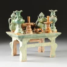 A SANCAI GLAZED AND BUFF POTTERY TOMB OFFERINGS TABLE, POSSIBLY MING DYNASTY, CIRCA 1560 A.D.,