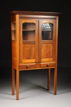 AN AMERICAN CARVED CHERRY CABINET, 19TH CENTURY,