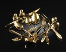 A DIRILYTE GOLD TONED FLATWARE SERVICE FOR EIGHT, 20TH CENTURY